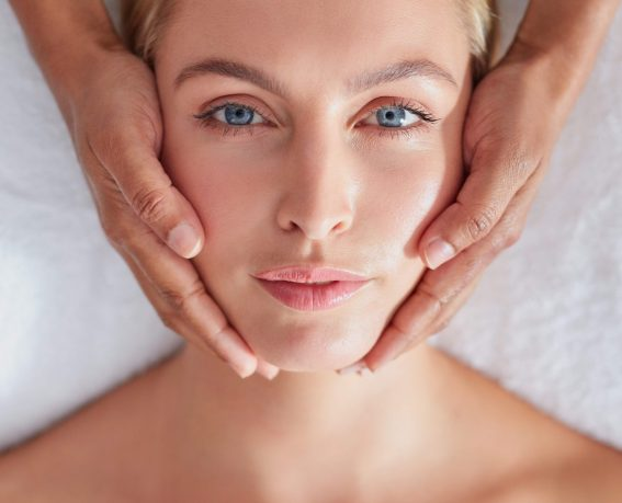 Top view close up shot of a relaxed woman on massage table enjoying beauty treatment at spa